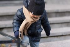 14 a black puffer jacket, a black beanie and a beige scarf for a stylish boy's look