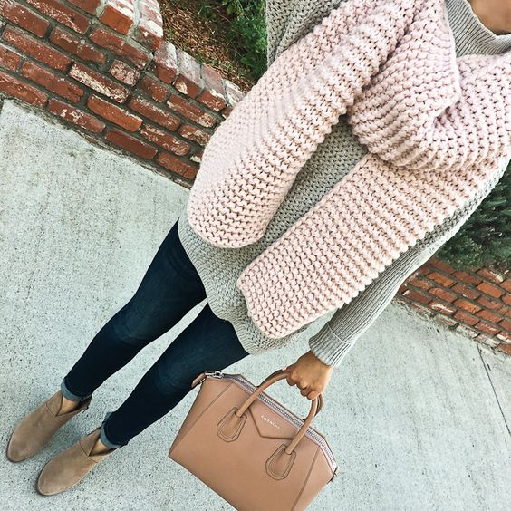 a light green sweater, a blush scarf, navy jeans, brown booties