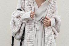 14 a neutral wrap dress and a matching chunky cardigan over it looks amazing