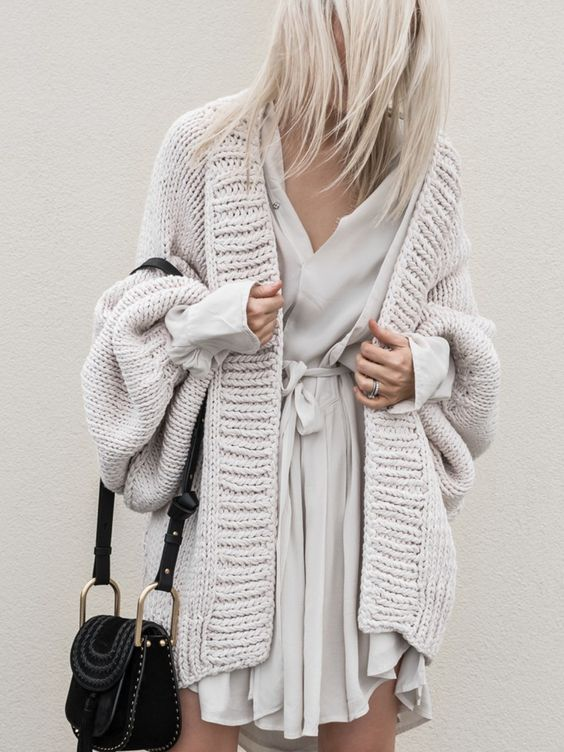 a neutral wrap dress and a matching chunky cardigan over it looks amazing
