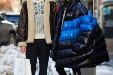 14 an oversized black and neon blue puffer coat makes a statement in winter colors
