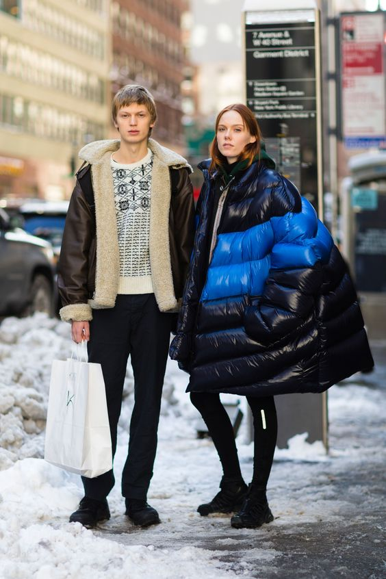 an oversized black and neon blue puffer coat makes a statement in winter colors