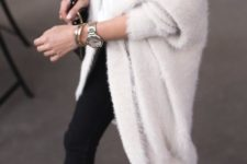 14 black jeans, a white tee, lace up shoes and a white long angora cardigan