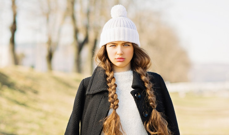 loose braids always look chic under a beanie