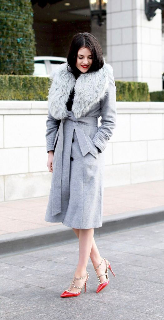 a grey winter coat with faux fur and red spiked Valentino shoes to look adorable