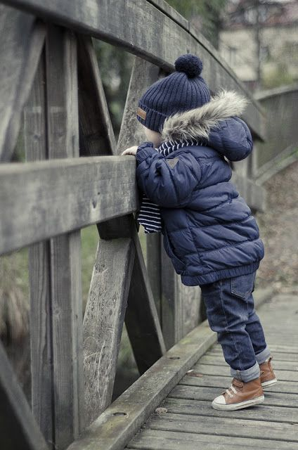 a navy puffer jacket with grey faux fur and a navy beanie for a stylish boy toddler look