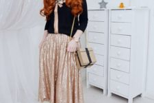 15 a printed black sweater with a gold bow, a gold sequin midi skirt and black pumps