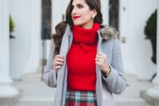 15 a red turtleneck sweater, a plaid mini skirt, a grey parka and black tights