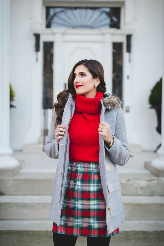 a red turtleneck sweater, a plaid mini skirt, a grey parka and black tights