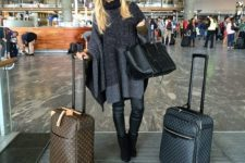 15 black leather pants, black suede boots, a large comfy poncho and a comfy bag