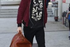 15 black pants, a printed sweatshirt, black boots and a hoodie by Ryan Gosling