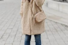 15 cropped jeans, a faux fur fuzzy coat, creamy sock boots and a beanie