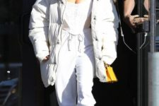 16 Kim Kardashian wearing a monochrome outfit with a white puffer coat looks chic