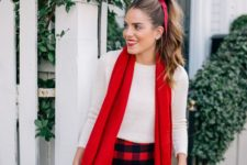 16 a white long sleeve top, a plaid mini, black tights and a red scarf