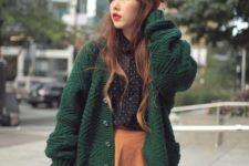 16 an orange mini skirt, a polka dot black shirt, an emerald cardigan for a cute look