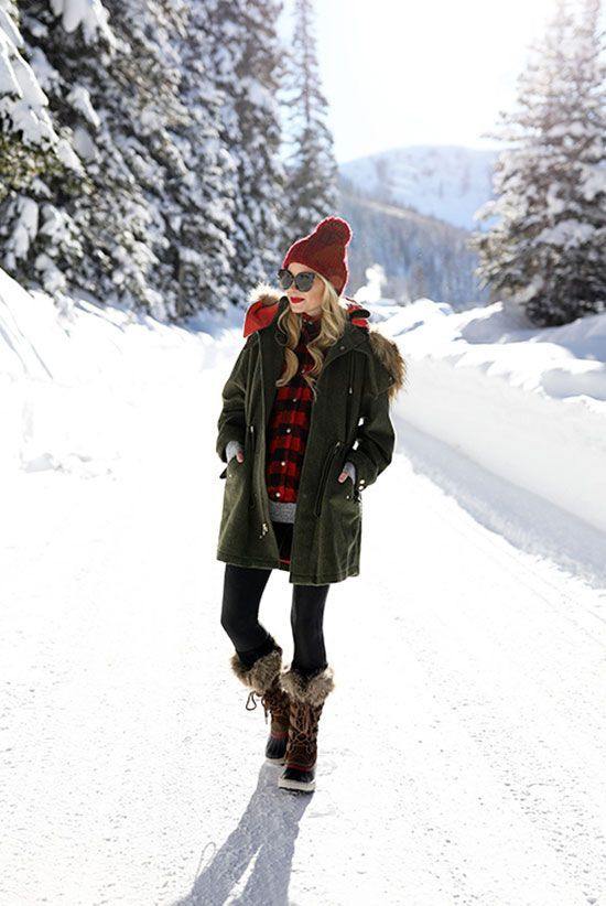black leggings, a plaid shirt, faux fur boots, an olive green parka for snowy weather
