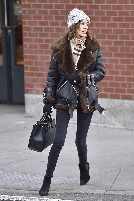 black skinnies, a black shearling coat, a plaid scarf, black chelsea boots