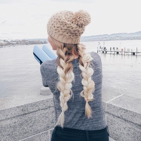 two voluminous braids with a neutral beanie is a great idea to show off your hair and feel comfy