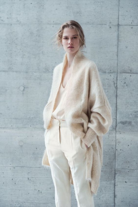 white trousers, a white top and a creamy long angora cardigan for a neutral look