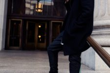 Black beanie, coat, pants and leather boots