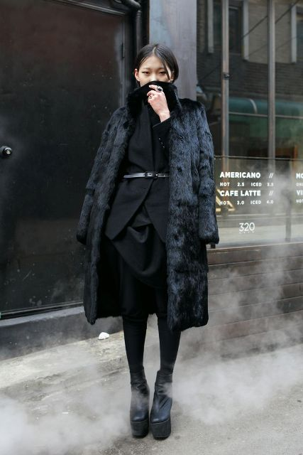 Black dress, fur coat and platform boots