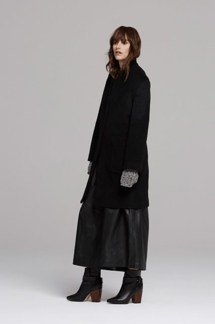 Black knee-length coat, leather maxi skirt and heeled boots