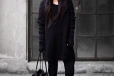 Black long sweater with straight pants, ankle boots, beanie and tote
