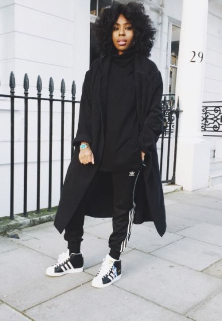 Black loose shirt, sporty pants, black and white sneakers and midi coat