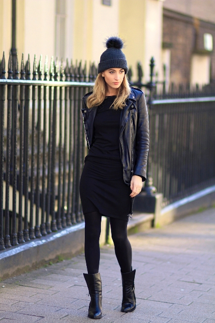 Black mini dress with leather jacket, beanie with pom pom and mid calf boots