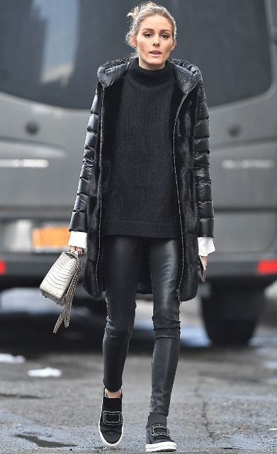 Black puffer coat with sweater, leather pants, embellished shoes and metallic mini bag