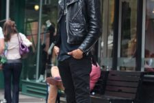 Black t-shirt, leather jacket, skinny pants, shoes and wide brim hat
