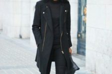 Black turtleneck, coat, pants, leather boots and clutch