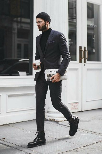 Black turtleneck with suit, mid calf boots and beanie