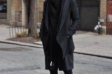 Black wide brim hat, scarf, loose coat, skinny pants and platform shoes