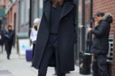 Combination of black shirt, crop pants, flat shoes and coat