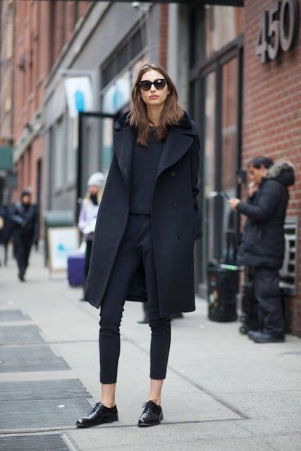 Combination of black shirt, crop pants, flat shoes and coat