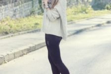 With beanie, sweater and skinny pants