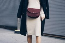 With beige knee-length dress, marsala bag and black coat