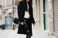 With beige shirt, black coat, sneakers, cap and small bag