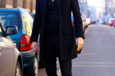 With black button down shirt, coat, pants and brown boots