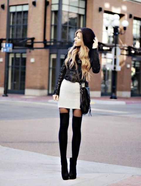 With black hat, white mini skirt, jacket and crossbody bag