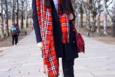 With black hat, white shirt, navy blue blazer, straight pants and flat shoes