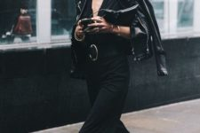 With black jumpsuit, leather jacket and beret