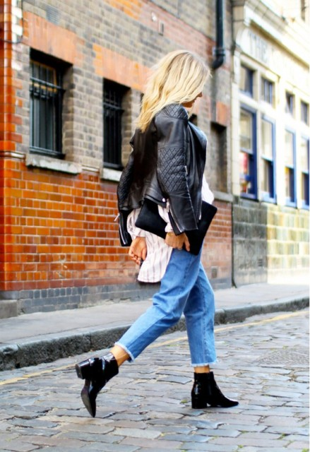 With black leather jacket, ankle boots and clutch