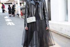 With black leather jacket, black turtleneck, mini bag and sheer skirt