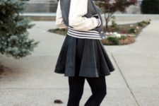 With black leather skirt, black tights and ankle boots
