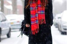 With black maxi coat, maxi dress, fur hat and bag