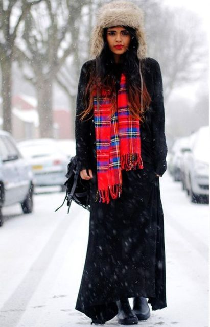 With black maxi coat, maxi dress, fur hat and bag
