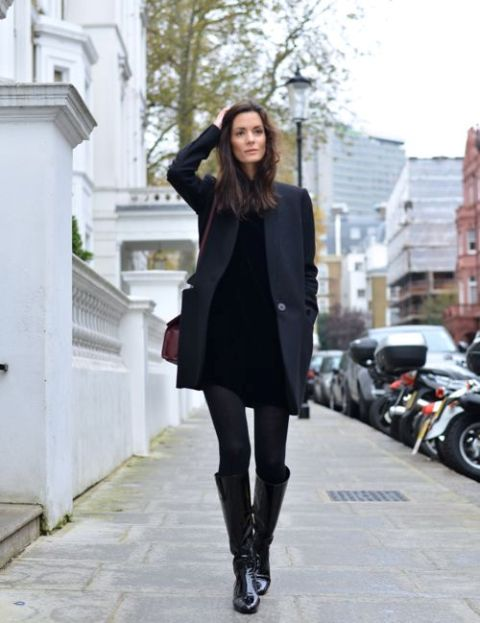 With black mini dress, black coat and brown bag