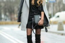 With black mini dress, gray coat, wide brim hat and small bag
